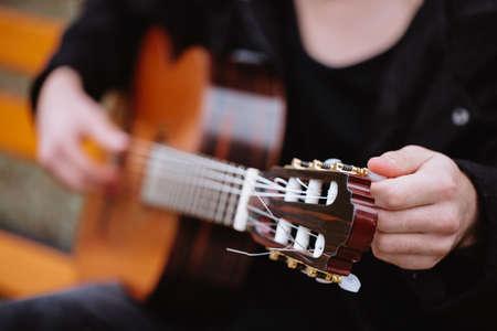 Tune acoustic guitar Stock Photo