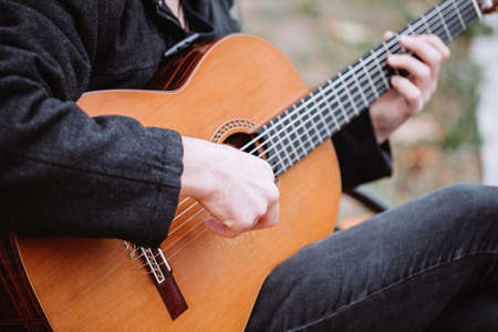 Play to the music with guitar
