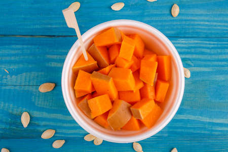 Tasty pumpkin on the blue background. Food concept. Stock Photo