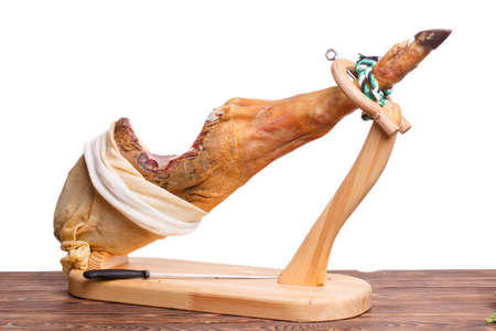 Jamon juicy on a stand close-up on a white isolated background Reklamní fotografie