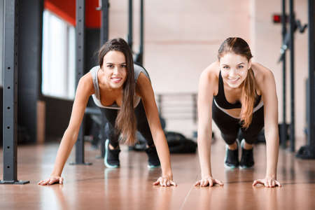 Two young athletes stand in a static horizontal position. Stock Photo
