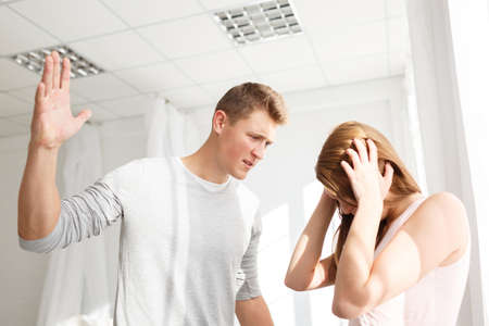 The quarrel of a guy and a girl. A young couple swears. The concept of quarrels in families.