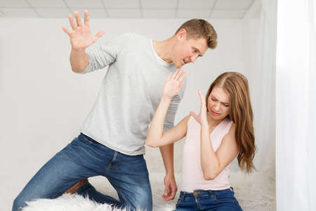 The quarrel of a guy and a girl Stock Photo