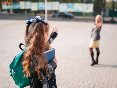 first year student: The girl goes to school with a briefcase and books Stock Photo