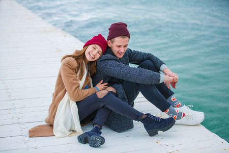 Cheerful young couple having fun and laughing together outdoors. Stock Photo