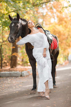 The girl pressed her back to the horse and looked up into the autumn park.