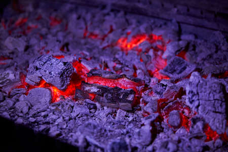 ablaze: Hot coals in a large barbecue close up in a restaurant Stock Photo