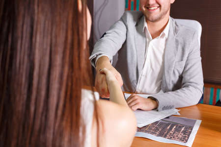 Businessmen shake hands at meeting Stock Photo