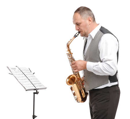 Man playing saxophone on white isolated background stand with notes