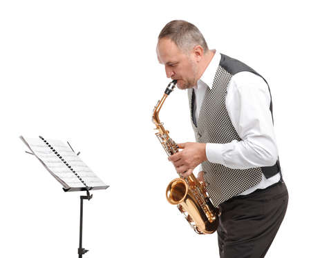 Man bent down playing saxophone on white isolated background