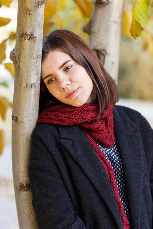 Sad girl in the park in autumn