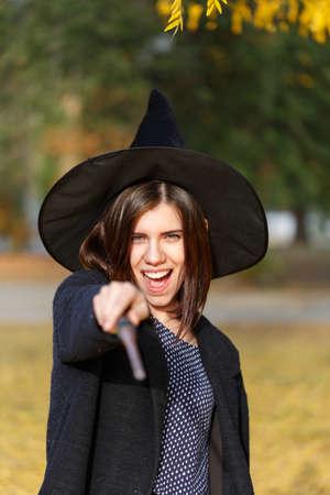 A girl make a magic dress in the park