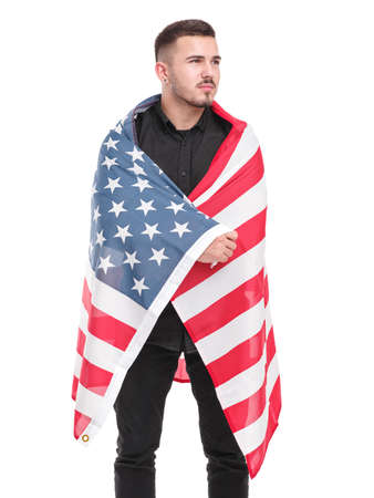 Man wrapped in an American flag in full growth isolated on white background