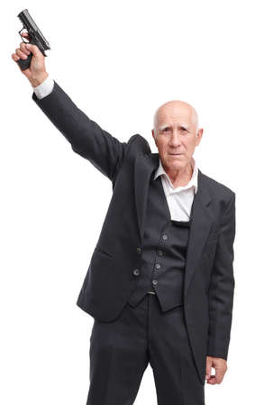 Portrait, elderly grandfather in suit holds in raised hand up pistol isolated on white background Stock Photo