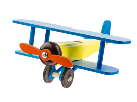Wooden childrens colored airplane isolated on white background. Banco de Imagens