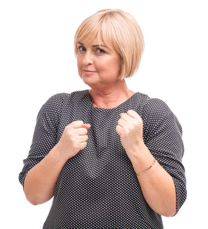 Adult female, blond, isolated on white background, clasped hands in fist. Stock Photo