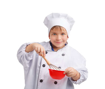 A small cook is stirring something in a plate. Front view on white isolated background Stock Photo