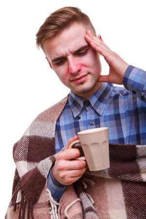 Sick guy holding his head in pain against white isolated background Stock Photo