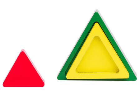 Different triangles in color and size for the development of a child on a white isolated background