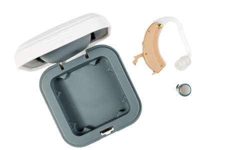 Hearing aid next to a box isolated on white isolated background