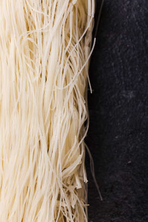 Close-up rice noodles on a nori . Indoors. Stock Photo