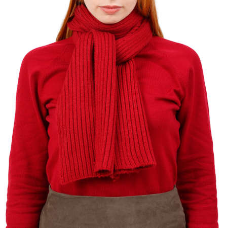 Red scarf and sweater on a slender girl. Isolated on white background.
