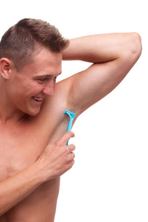 A guy with fur shaves his armpit with a razor on a white isolated background