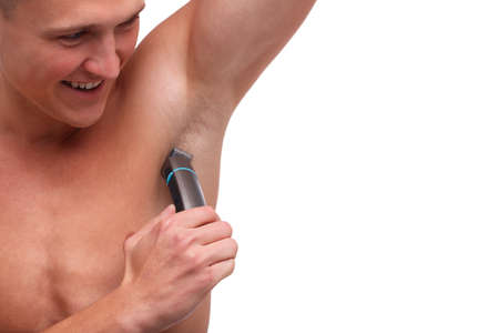Guy with fur shaving underarm trimmer close-up on white isolated background Stock Photo