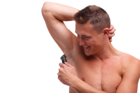 Guy with fur shaving underarm trimmer on white isolated background