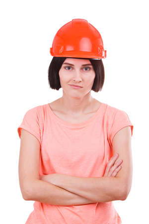 Girl standing in a helmet with hands clasped on a white isolated background