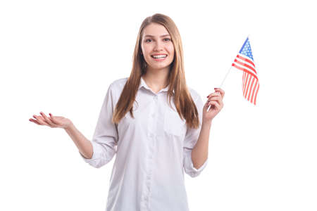 Girl holding an American flag on sticks on a white isolated background