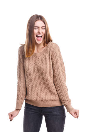 Girl screaming strongly with closed eyes on a white isolated background