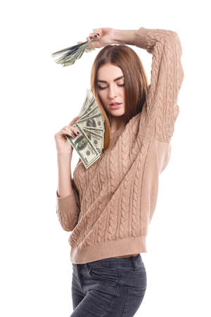 Girl in sweater holding money fan in hands on white isolated background