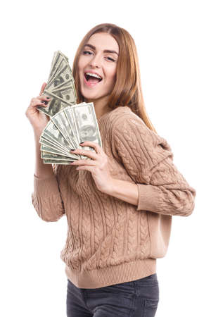 Happy girl holding money fan in hands on white isolated background