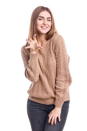 The girl is holding her hand with fingers spread out like a cat on a white isolated background