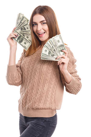 Girl holding money fan at face on white isolated background