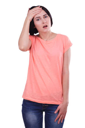 A girl upset holds her hand on her forehead on a white isolated background