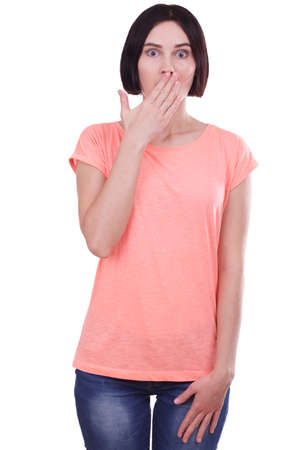 Surprised girl covers her mouth on a white isolated background Stock Photo