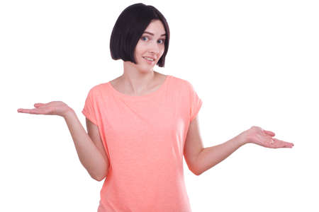 A girl spreads her hands in a tilted head on a white isolated background