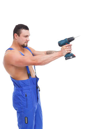 A man stands sideways and holds a screwdriver on his extended arms on a white isolated background