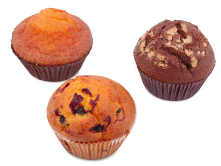 Three cupcakes with various fillings, isolated on a white background, lie on their side, chocolate, with raisins, vanilla.