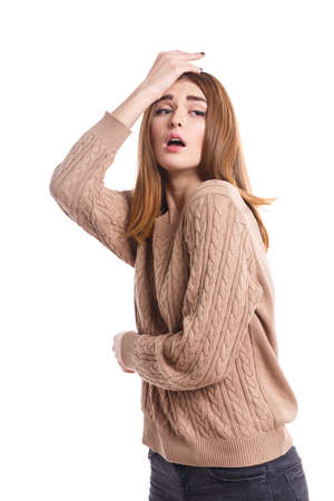 Disappointed girl is frustratedly holds the palm of forehead. Isolated. Stock Photo