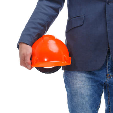 Head holds a hard hat close-up on a white isolated background