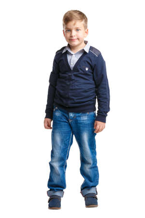 A little boyin beautiful clothes on white isolated background