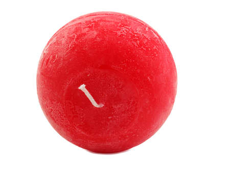 Red, bright, round wax candle with a wick lies in an inverted shape, isolated on a white background