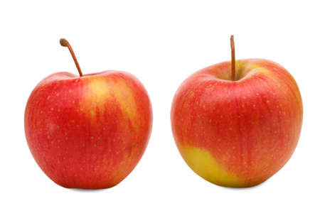 Close-up of two juicy, appetizing apple, isolated on white background, lie side by side, not in touch