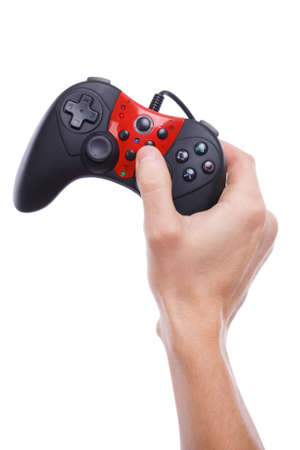 A hand holds a joystick with a thumb on the stick on a white isolated background