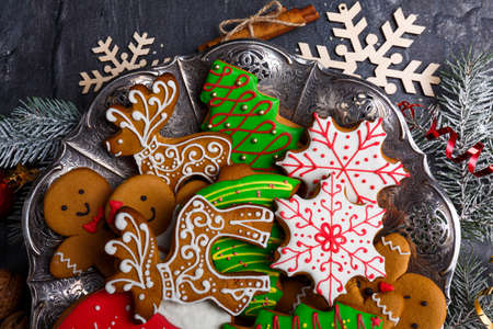 Christmas cookies of different shapes and with sugar icing. View from above. Stock Photo
