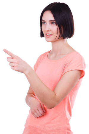 A European girl shows her index finger somewhere. Isolated.
