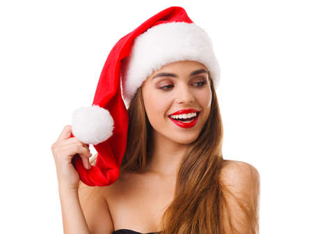 A happy girl in a red hat and in a black dress is smiling broadly. Isolated. Stock Photo